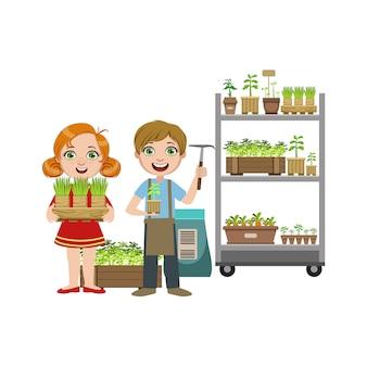 Ragazze e ragazzo con inventario giardinaggio