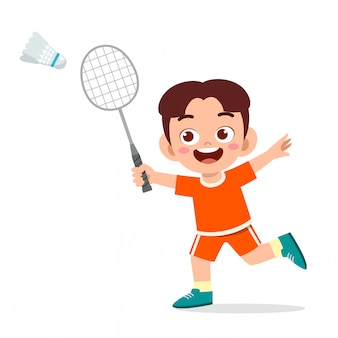 Ragazzo carino bambino felice giocando a badminton