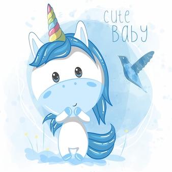 Ragazzo carino unicorno su sfondo blu