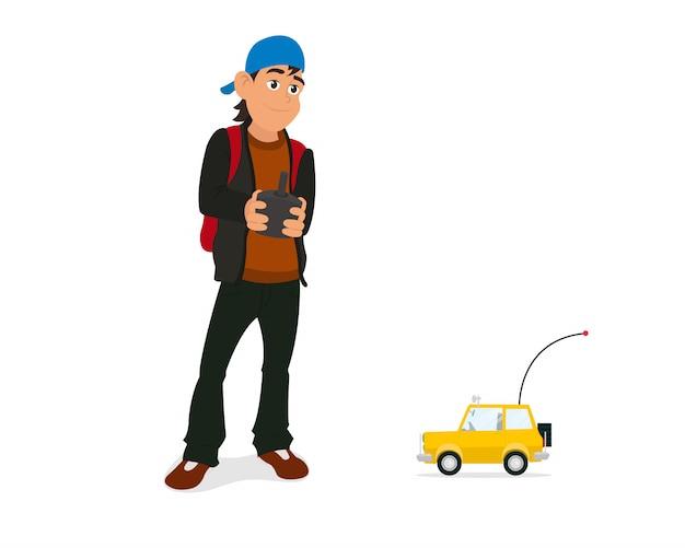 Ragazzo che gioca con l'automobile del rc con telecomando in mani
