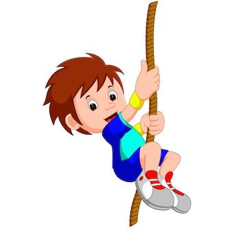 Ragazzo che oscilla su una corda