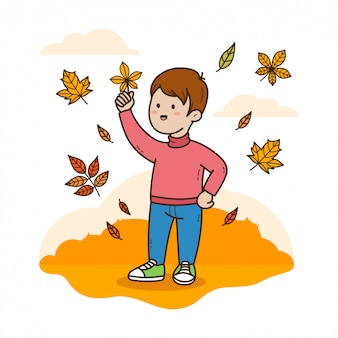 Ragazzo che tiene la foglia d'autunno
