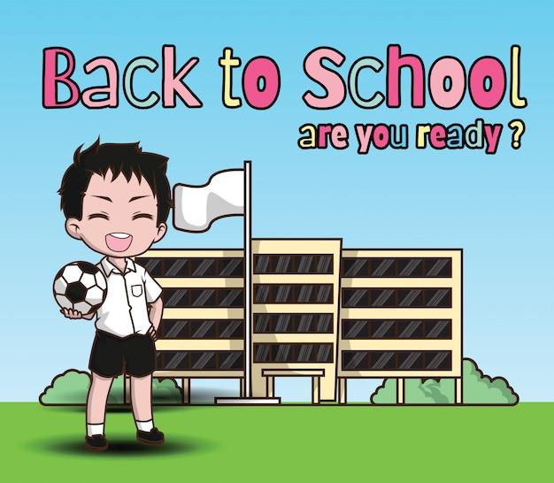 Ragazzo che tiene un pallone da calcio a scuola torna al modello di scuola.