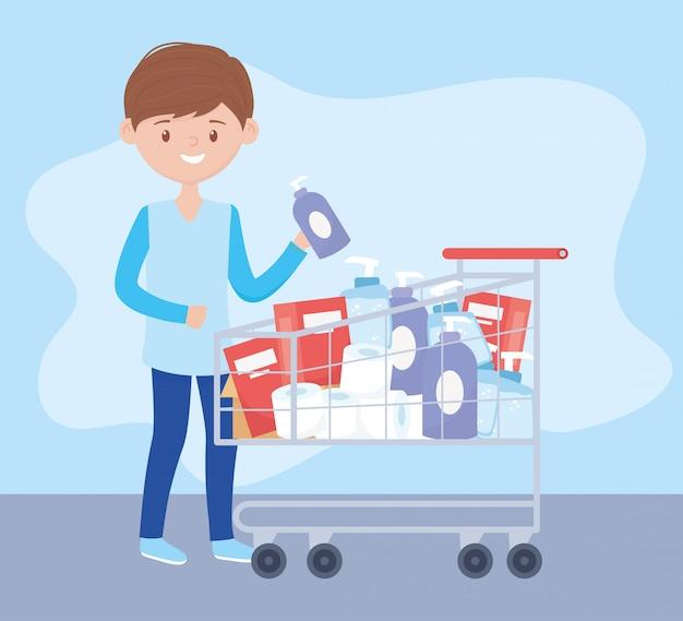 Ragazzo con un carrello pieno di prodotti per la pulizia e cura l'acquisto in eccesso