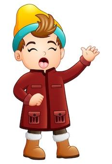 Ragazzo del fumetto in abiti invernali cantando