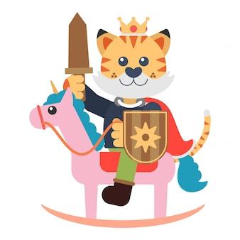 Ragazzo della tigre che gioca essendo re in un unicorno di legno