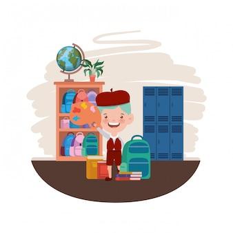 Ragazzo dello studente con i rifornimenti di scuola nell'aula