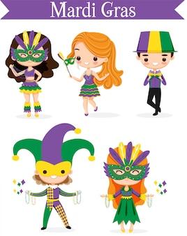 Ragazzo e ragazza carini in costume da giullare per il festival del mardi gras
