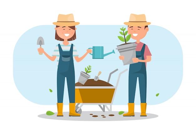 Ragazzo felice e ragazza che piantano un albero all'aperto