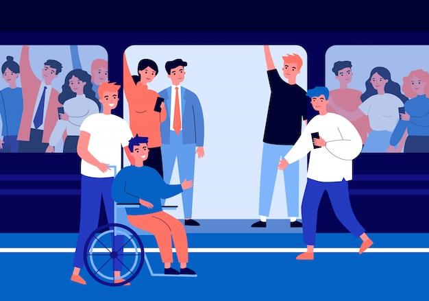 Ragazzo handicappato e il suo aiutante che viaggiano in metropolitana