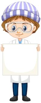 Ragazzo in abito di scienza che tiene bordo bianco
