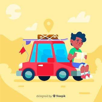 Ragazzo in viaggio con una macchina