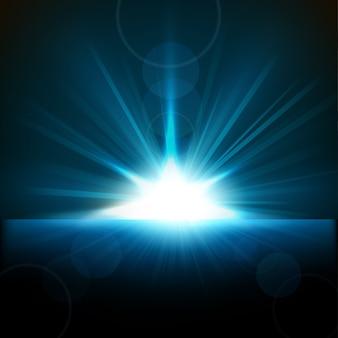 Raggi blu che sorgono dall'orizzonte
