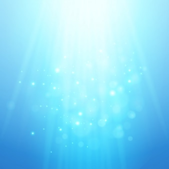 Raggi di luce blu. priorità bassa vaga bokeh di vettore