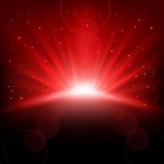 Raggi rossi in aumento sfondo con scintillii