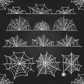 Ragnatela bianca sul contesto della lavagna. confini e decorazioni di halloween
