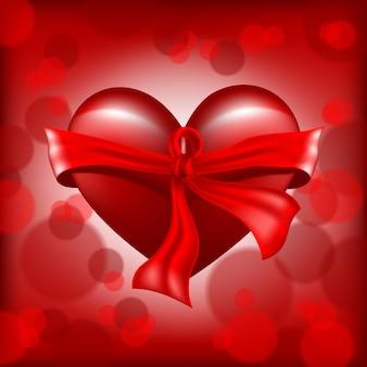 Realistico cuore rosso con nastro