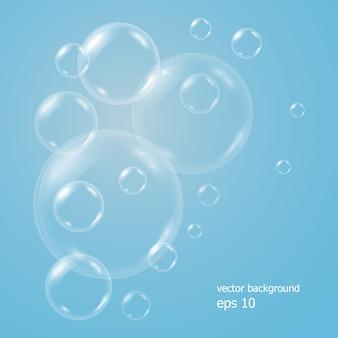 Realistico sfondo blu con bolle d'acqua sapone trasparente, palle o sfere.