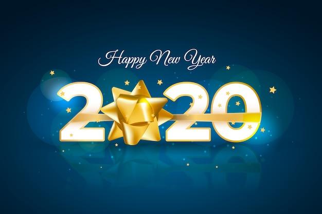Realistico sfondo del nuovo anno 2020 con fiocco regalo dorato