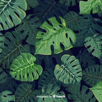 Realistico sfondo di foglie tropicali