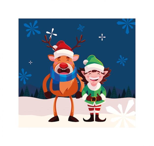 Renna ed elfo con cappello nel paesaggio invernale
