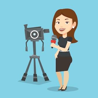 Reporter tv con microfono e videocamera.