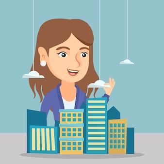 Responsabile delle vendite caucasico che presenta il modello della città.