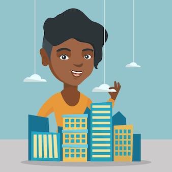 Responsabile vendite africano che presenta il modello di città.