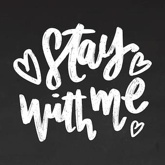 Resta con me scritte sulla lavagna
