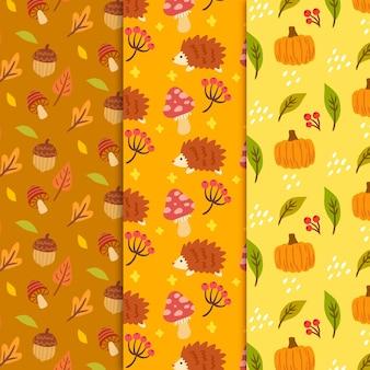 Reticolo di autunno disegnato a mano con zucca e foglie