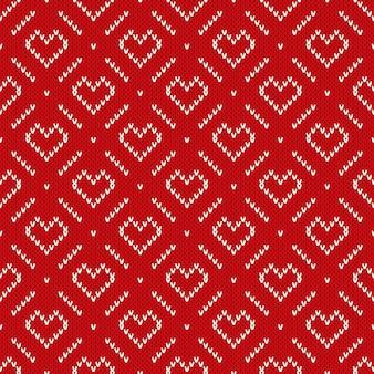 Reticolo lavorato a maglia di vacanza invernale con cuori. fondo senza cuciture di san valentino