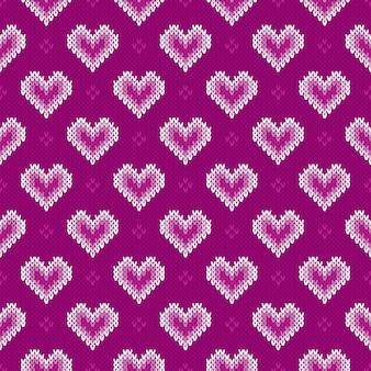 Reticolo lavorato a maglia senza giunte con i cuori. sfondo di san valentino