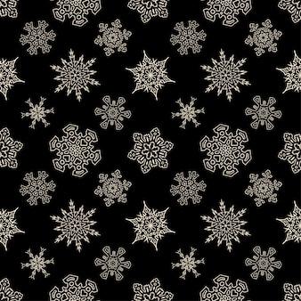 Reticolo nero senza giunte di natale con i fiocchi di neve disegnati