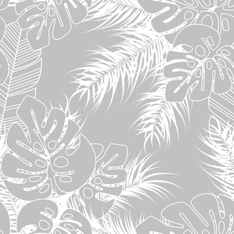 Reticolo tropicale senza giunte di estate con foglie di palma monstera e piante su sfondo grigio