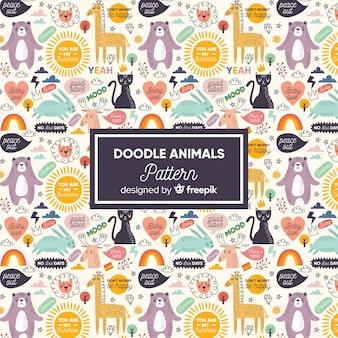 Reticolo variopinto di animali e parole di doodle