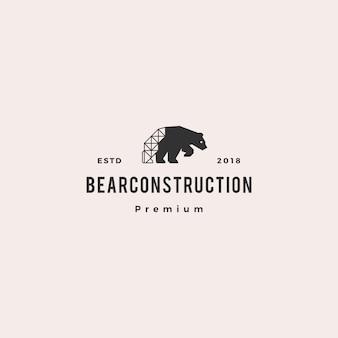Retro annata dei pantaloni a vita bassa di logo della costruzione dell'orso polare