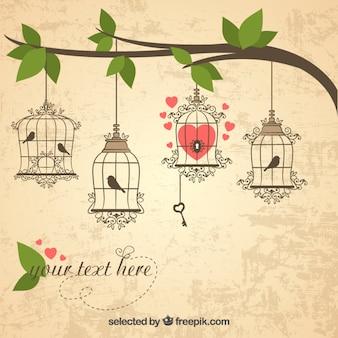Retro gabbie per uccelli appese su un ramo