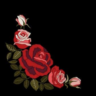 Ricamo di rose rosse su sfondo nero.