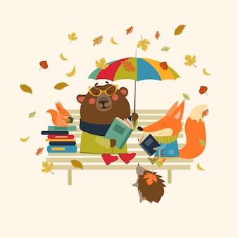 Riccio e scoiattolo leggendo libri sul banco