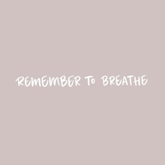 Ricorda di respirare la frase calligrafica sul rosa pallido