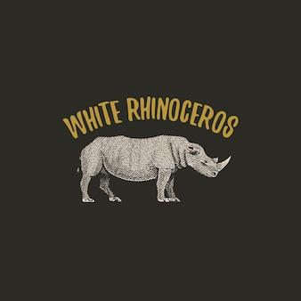 Rinoceronte bianco inciso disegnato a mano nel vecchio stile di schizzo, logo animali vintage