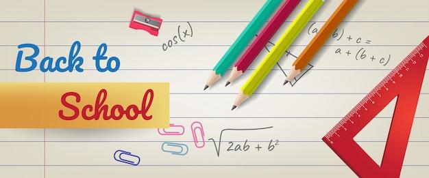 Ritorno a scuola lettering su carta a righe con matite e righello