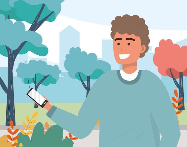 Ritratto mandante un sms millenario dello smartphone del giovane