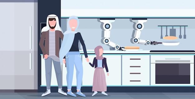 Robot a portata di mano del cuoco unico astuto che prepara i pancake deliziosi sulla padella per la famiglia araba assistente robotico tecnologia dell'innovazione concetto di intelligenza artificiale orizzontale moderna dell'interno della cucina