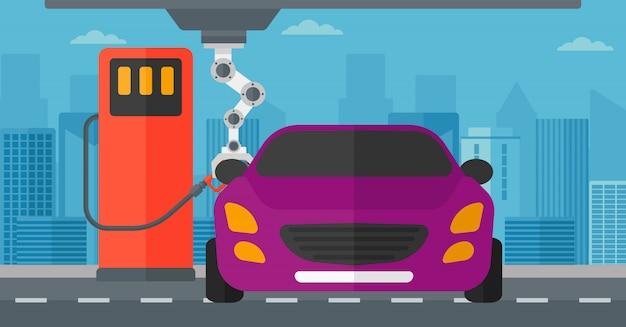 Robot riempiendo il carburante in auto alla stazione di benzina.