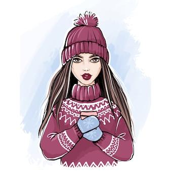 Romantica ragazza invernale in maglione lavorato a maglia e cappello godendo una tazza di caffè