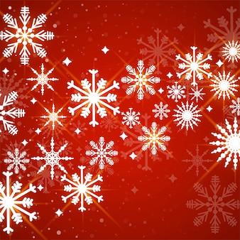 Rosso con sfondo di fiocchi di neve