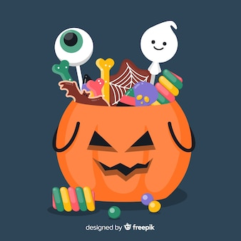 Sacchetto piatto di zucca di halloween pieno di caramelle