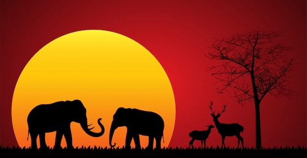 Sagoma nera di elefante e cervi