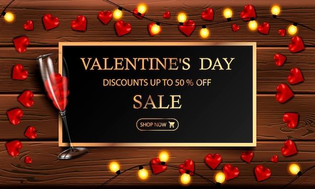 Saldi di san valentino, fino al 50% di sconto, moderno banner orizzontale o poster con una ghirlanda gialla